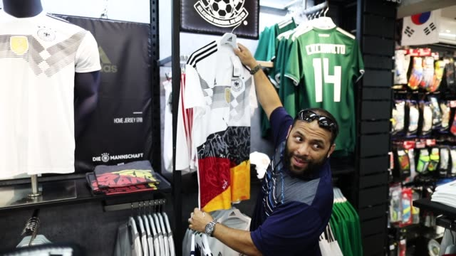 rodrigo prego and his family shop at the soccer locker store for german soccer team items as they prepare to show their support for their favorite... - shirt stock videos & royalty-free footage