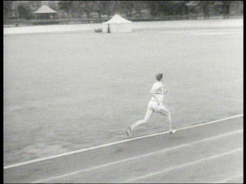 roger bannister being timed by coach while running around athletics track training for sub four minute mile england 1954 - bannister stock videos & royalty-free footage