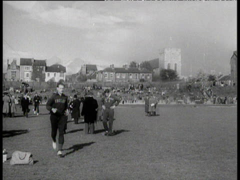 roger bannister jogs past camera in tracksuit pre race iffley road oxford 6 may 1954 - bannister stock videos & royalty-free footage