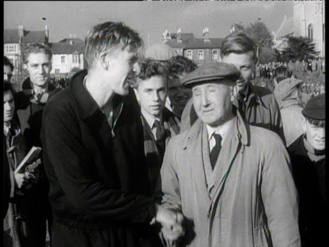 roger bannister shakes hands and thanks iffley road groundsman minutes after being the first man to run a sub four minute mile oxford 6 may 1954 - bannister stock videos & royalty-free footage