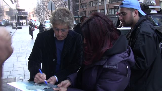 roger daltrey exits good day new york and signs for fans in new york, ny, on 2/28/13. - roger daltrey stock-videos und b-roll-filmmaterial