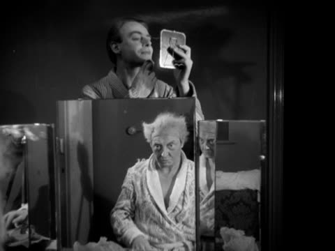 roger livesey puts a wig on in a dressing room at the old vic theatre. - actor stock videos & royalty-free footage
