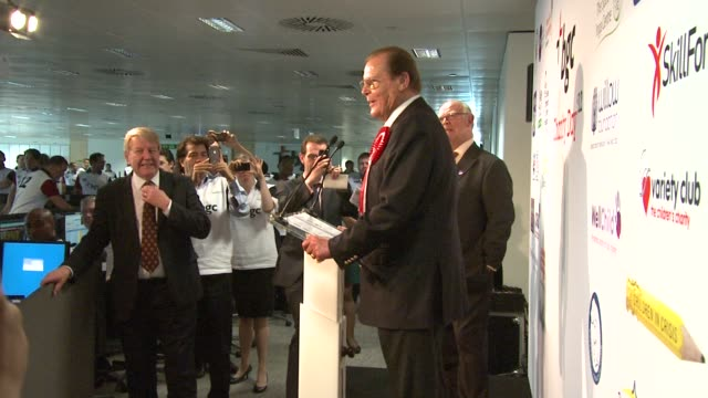 roger moore at bgc annual global charity day at bgc partners on september 11, 2012 in london, england - 俳優 ロジャー・ムーア点の映像素材/bロール