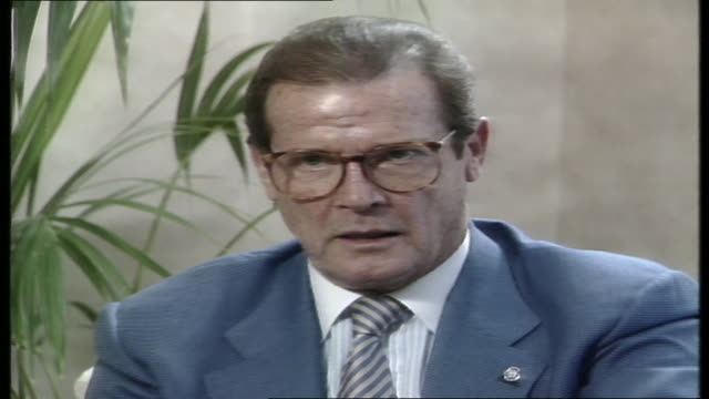 roger moore in sydney for unicef interview with stan grant talks re poverty and exploitation - unicef stock videos & royalty-free footage