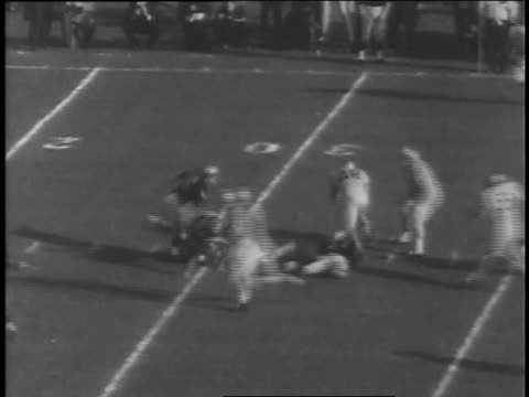 roger staubach completes a pass at an army vs. navy football game. - navy stock videos & royalty-free footage