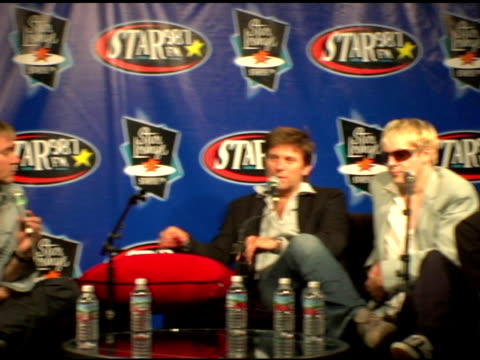 stockvideo's en b-roll-footage met roger taylor nick rhodes and andy taylor of duran duran at the duran duran debuts of their new single at star 987 fm radio in burbank california on... - duran duran