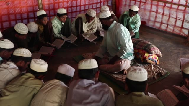 rohingya boys attend religious studies at a madrasa in the balukhali camp in cox's bazar bangladesh on february 11 2019 - madressa stock videos and b-roll footage