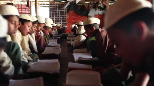 Rohingya boys attend religious studies at a madrasa in the Balukhali camp in Cox's Bazar Bangladesh on February 11 2019
