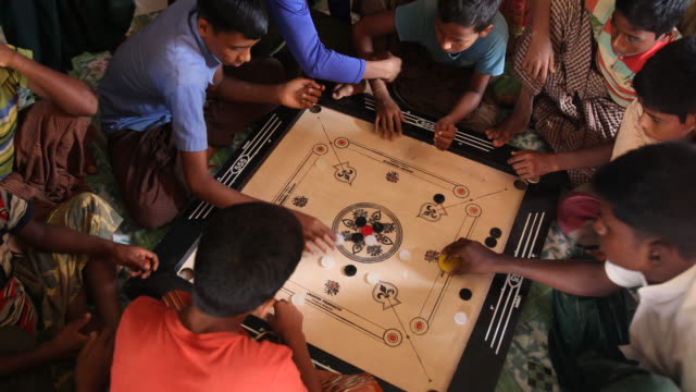 rohingya children in the camp during an educational event of an ngo, playing a game. refugee camp of the rohingyas near cox's bazar in bangladesh in... - bamboo plant stock-videos und b-roll-filmmaterial