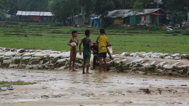 rohingya children play football inside a refugee camp in cox's bazaar bangladesh on august 04 2018 - cox's bazaar stock videos and b-roll footage
