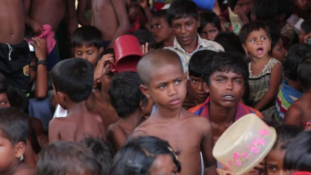 Rohingya children wait for food aid near the Palongngkhali makeshift camp in Teknaff Bangladesh on October 06 2017 Bangladesh said it would be one of...