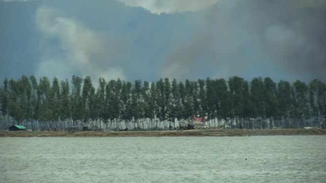 Rohingya continue to flee as UN condemns ethnic cleansing BANGLADESH EXT Various of view across river into Myanmar as clouds of smoke rise into the...