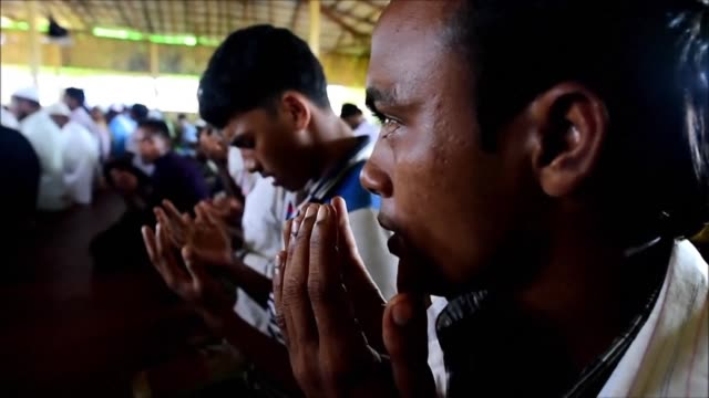 rohingya imams offer special prayers for a safe return to their homeland ahead of the second anniversary of hundreds of thousands of the minority... - praying stock videos & royalty-free footage