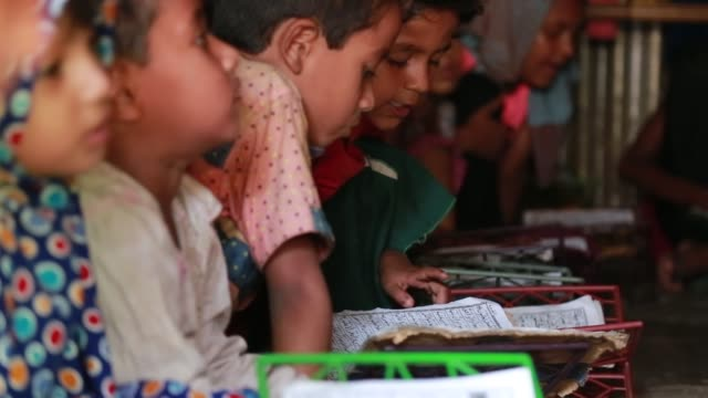 rohingya learn arabic inside a school at refugee camp at cox's bazar , bangladesh on may 02, 2018. violence erupted in myanmar's rakhine state on... - school child stock videos & royalty-free footage