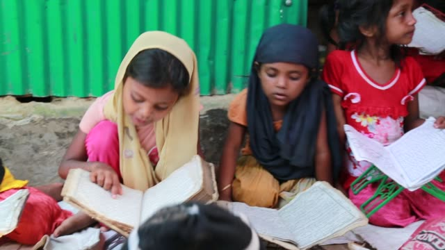 COX's BAZAR BANGLADESH MAY 02 Rohingya learn Arabic inside a school at refugee camp at Cox's Bazar Bangladesh on May 02 2018 Violence erupted in...