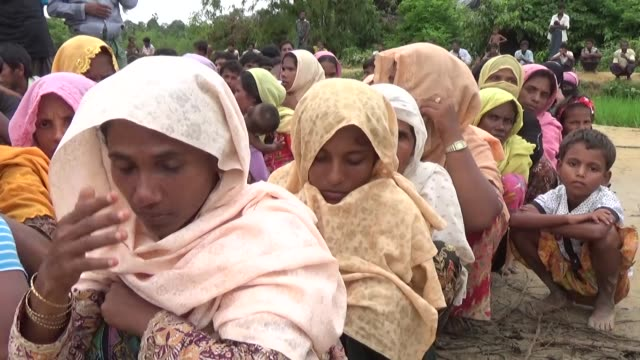 COX'S BAZAR BANGLADESH SEPTEMBER 21 Rohingya Muslims fled from ongoing military operations in Myanmar's Rakhine state receive food aid from...