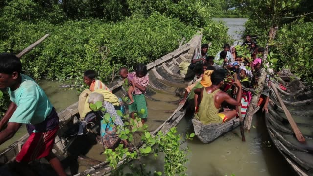 rohingya muslims fled from ongoing military operations in myanmar's rakhine state cross the bangladeshmyanmar border through boat to reach in teknaff... - rohingya culture stock videos and b-roll footage
