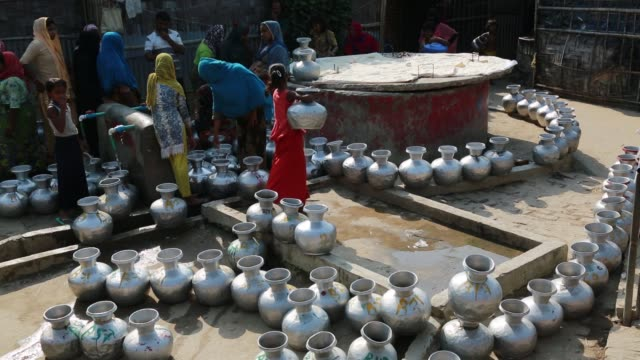 COX's BAZAR BANGLADESH MAY 02 Rohingya Muslims fled from ongoing military operations in Myanmar's Rakhine state waits for collect water at refugee...