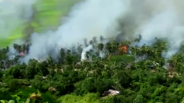 rohingya muslims flee their homes to the border with bangladesh due to ongoing clashes in western myanmar's rakhine state on august 29 2017 deadly... - myanmar stock videos & royalty-free footage