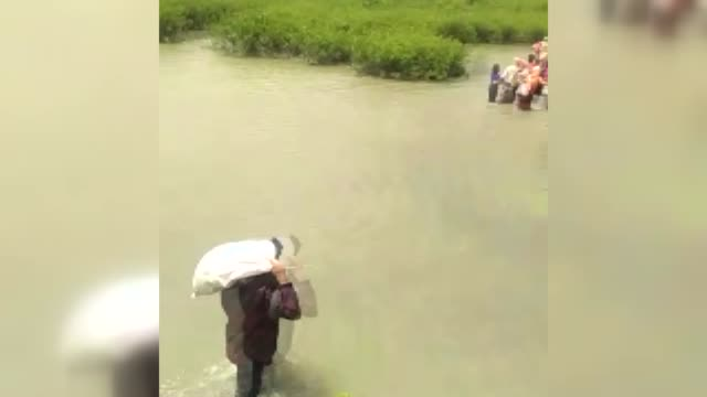 Rohingya Muslims flee their homes to the border with Bangladesh due to ongoing clashes in western Myanmar's Rakhine state on August 29 2017 Deadly...