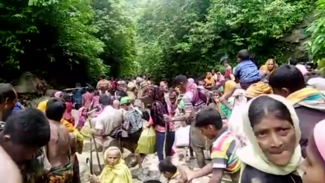 Rohingya Muslims who fled their homes in western Myanmar's Rakhine state due to the ongoing operations conducted by Myanmar's security forces walk...