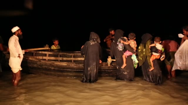 rohingya people fled from ongoing military operation in myanmar rakhain state reached at shah pori island by boat at night in shah pori island in... - rohingya culture stock videos and b-roll footage