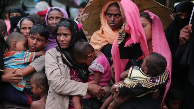 Rohingya people fled from ongoing military operation in Myanmar Rakhain state walks along the road at Shah Pori Island to go to refugee camp in Shah...