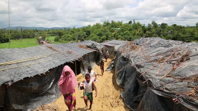 rohingya people, fled from ongoing military operation in myanmar rakhain state, take shelter in a refugee camp in tknaff in bangladesh on september... - mass murder stock videos & royalty-free footage