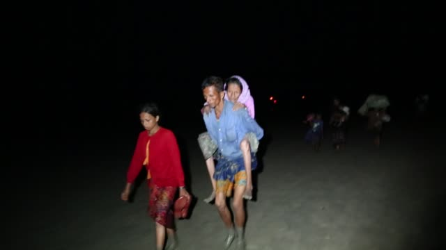 rohingya people fled from ongoing military operation in myanmar rakhain state entered bangladesh walks to go to refugee camp in tknaff in bangladesh... - journalist stock videos & royalty-free footage