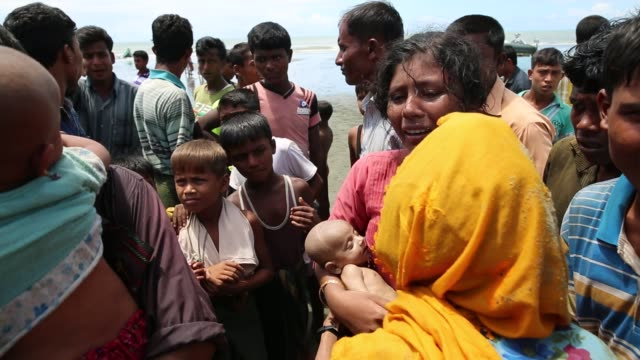 rohingya people, fled from ongoing military operation in myanmar rakhain state, capsize their boat and people had died while crossing sea in tknaff... - rohingya culture stock videos & royalty-free footage