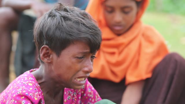 rohingya people, fled from ongoing military operation in myanmar rakhain state, entered bangladesh walks to go to refugee camp in cox's bazar in... - rohingya culture stock videos & royalty-free footage