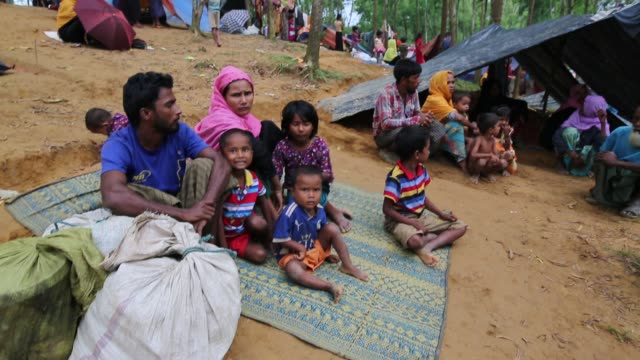 rohingya people, fled from ongoing military operation in myanmar rakhain state, entered bangladesh walks to go to refugee camp in cox's bazar in... - mass murder stock videos & royalty-free footage