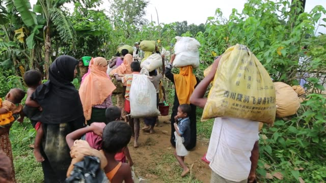 COX'S BAZAR BANGLADESH SEPTEMBER 03 Rohingya people fled from ongoing military operation in Myanmar Rakhain state entered Bangladesh walks to go to...
