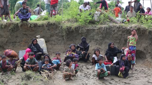 rohingya people sit on a makeshift shelter near the bangladeshmyanmar border as they are being restricted by the members of border guard bangladesh... - cox's bazar stock videos & royalty-free footage