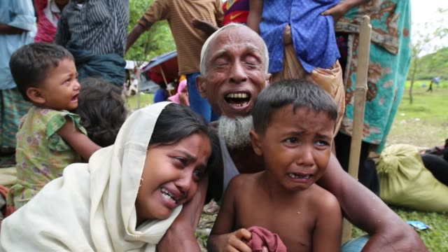 rohingya people weeping on a makeshift shelter near the bangladeshmyanmar border as they are being restricted by the members of border guard... - refugee stock videos & royalty-free footage