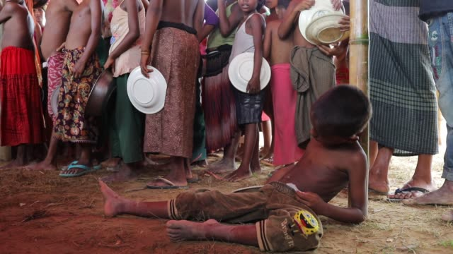 rohingya refugee boy got sleep when they waiting in a queue to get aid food at jamtoli rohingya refugee camp in cox's bazar according to unhcr more... - cox basar stock-videos und b-roll-filmmaterial