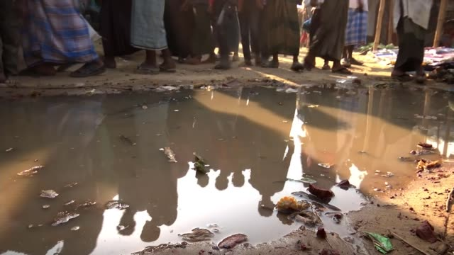 Controversial plan to relocate refugees to remote island BANGLADESH EXT Various shots of people along at refugee camp for Rohingya people Children...