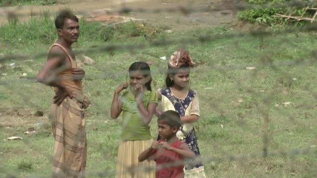 rohingya refugee crisis: united nations chief calls for halt to repatriation plans; myanmar, rakhine; reception centre on myanmar-bangladesh border /... - guarding stock videos & royalty-free footage