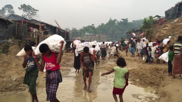 Rohingya Refugees are coming back to their shelter after collecting relief at Balukhali Rohingya Refugee camp Cox's Bazar Chittagong Bangladesh...