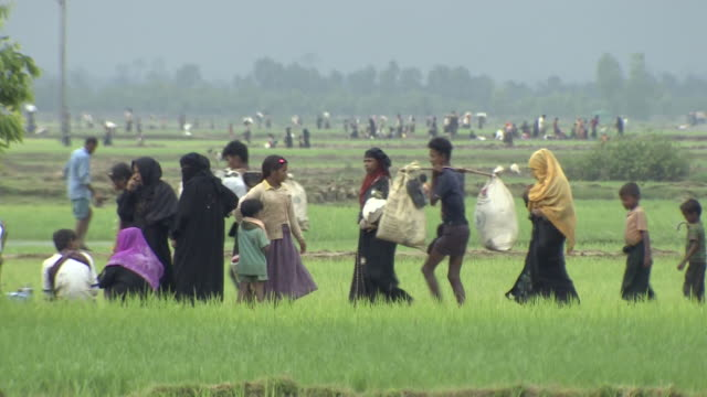 rohingya refugees arriving in bangladesh after fleeing persecution in burma - escaping stock videos & royalty-free footage