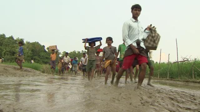 rohingya refugees arriving in teknaf, bangladesh after fleeing persecution in burma - rohingya culture stock videos & royalty-free footage