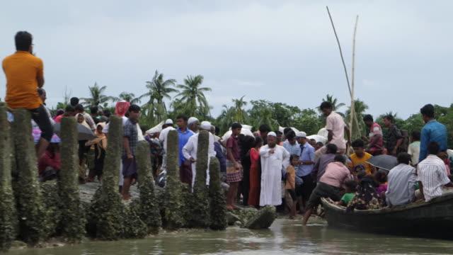 Rohingya refugees arriving in Teknaf Bangladesh after fleeing persecution in Burma