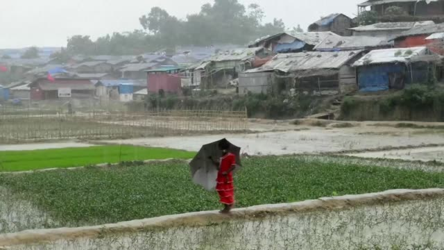 rohingya refugees face a downpour of rain during the monsoon season in the camps in bangladesh which hosts nearly a million rohingya muslims forced... - myanmar stock videos & royalty-free footage