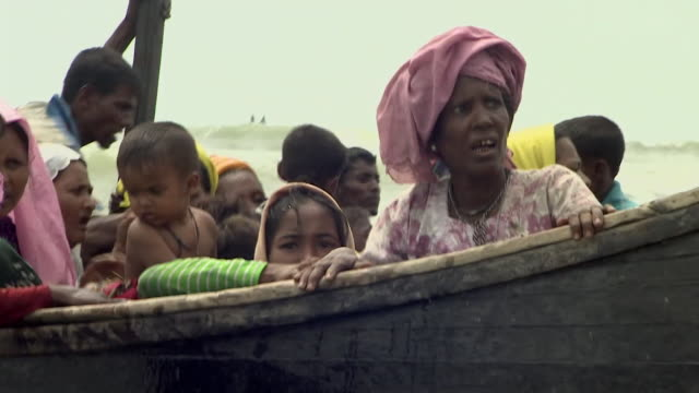 rohingya refugees from burma arriving by boat on the shores of bangladesh after fleeing persecution in rakhine state - crisis stock videos & royalty-free footage