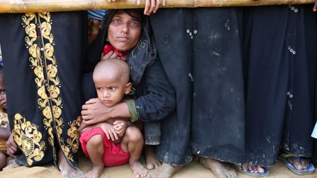 COX'S BAZAR BANGLADESH OCTOBER 05 Rohingya refugees wait for food handouts at a refugee camp in Cox's Bazar Bangladesh on October 05 2017