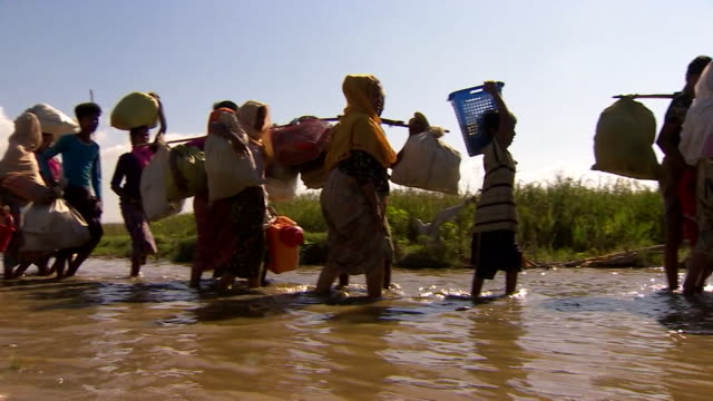 rohingya refugees walking through water on arrival in cox's bazar, bangladesh - refugee stock videos & royalty-free footage