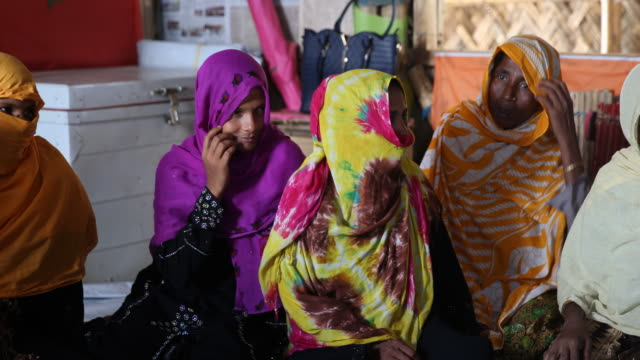 rohingya women, wearing a hijab and nikab during an educational event of an ngo in the camp. refugee camp of the rohingyas near cox's bazar in... - bamboo plant stock-videos und b-roll-filmmaterial