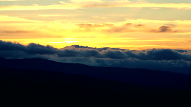 roiling sunset clouds in the distance orange - pacific crest trail stock videos & royalty-free footage