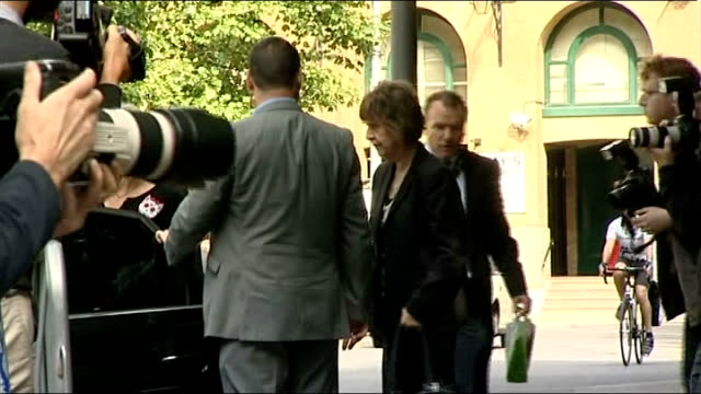 london southwark crown court ext rolf harris arriving at court with daughter bindi harris and niece jenny harris / harris entering court building - rolf harris stock videos and b-roll footage