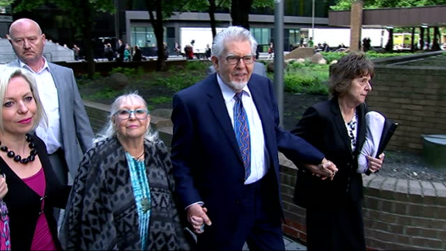 london southwark crown court photography *** rolf harris arriving at court with wife alwen hughes and daughter bindi - bindi stock videos and b-roll footage